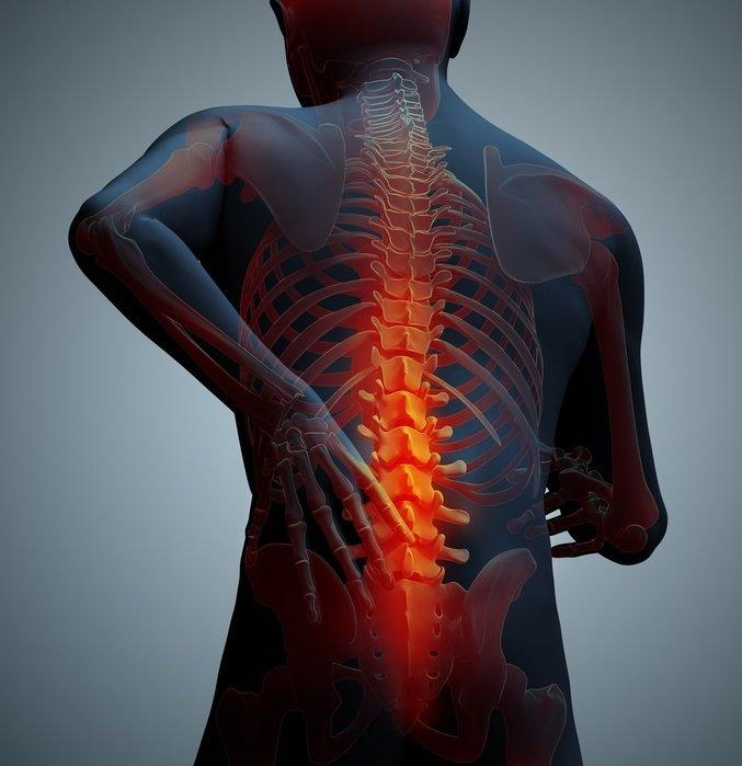 smärta i mitten av ryggen