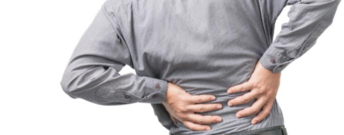 Man med ryggbesvär
