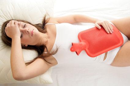 ont i magen som mensvärk